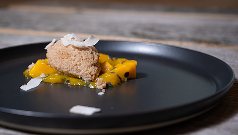 Coconut couscous with mango and passion fruit compote