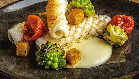 Grilled squid with Romanesco broccoli and crispy polenta cubes