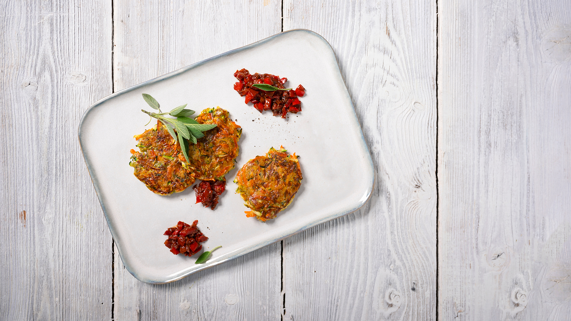 Courgette fritters with red pepper sugo