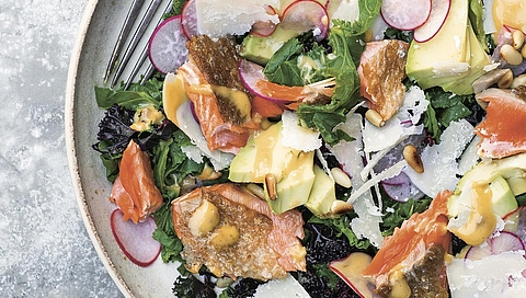 Pan-fried salmon and warm kale Caesar salad