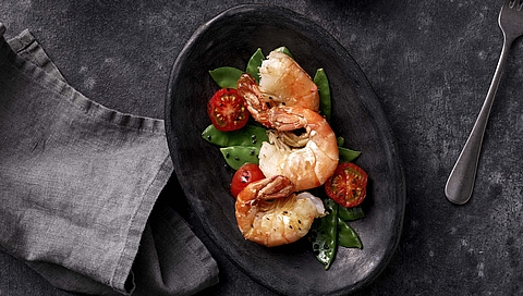 Prawns with sesame mangetout and cherry tomatoes