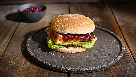 Halloumi burger with cranberry and maple sauce and lettuce