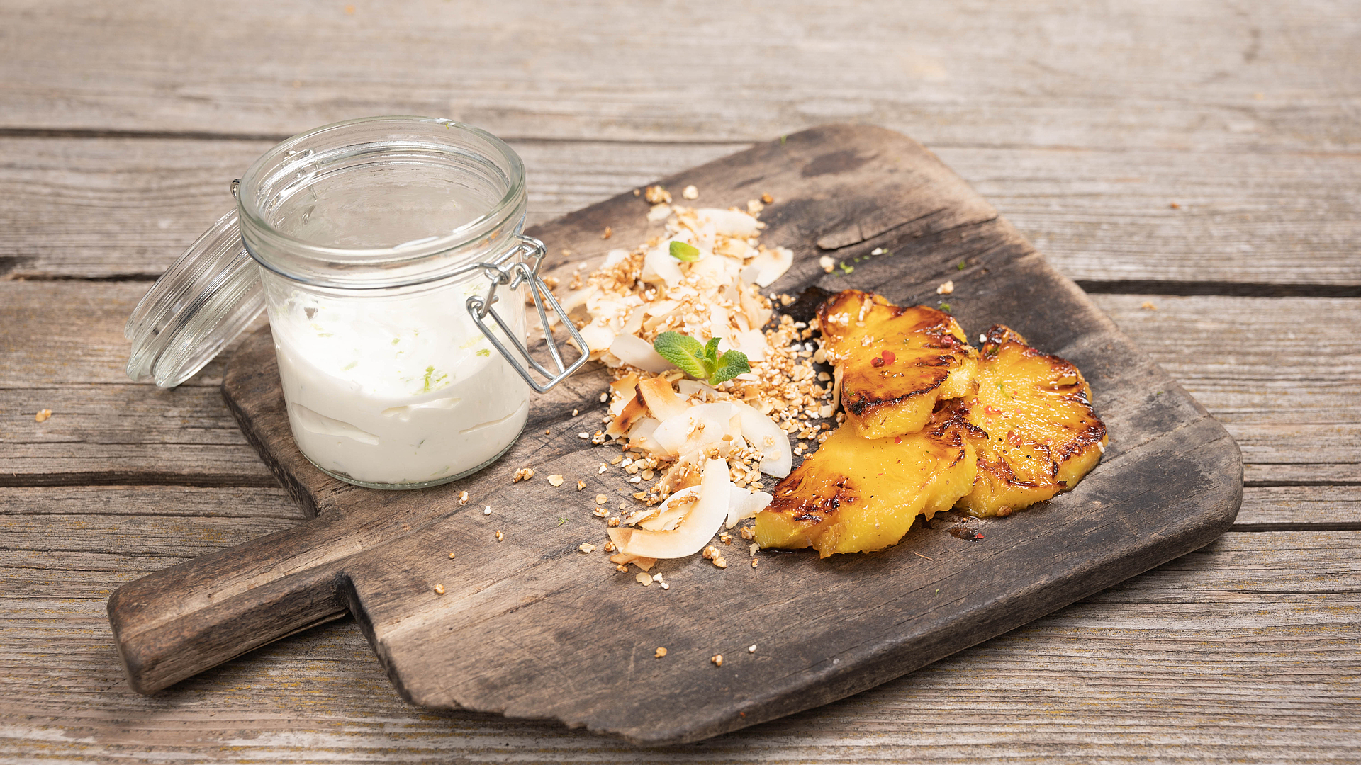 Grilled spiced pineapple with coconut crisps and coconut & lime yogurt