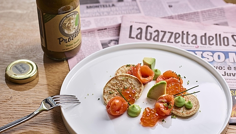 Buckwheat blinis with marinated salmon, caviar and avocado