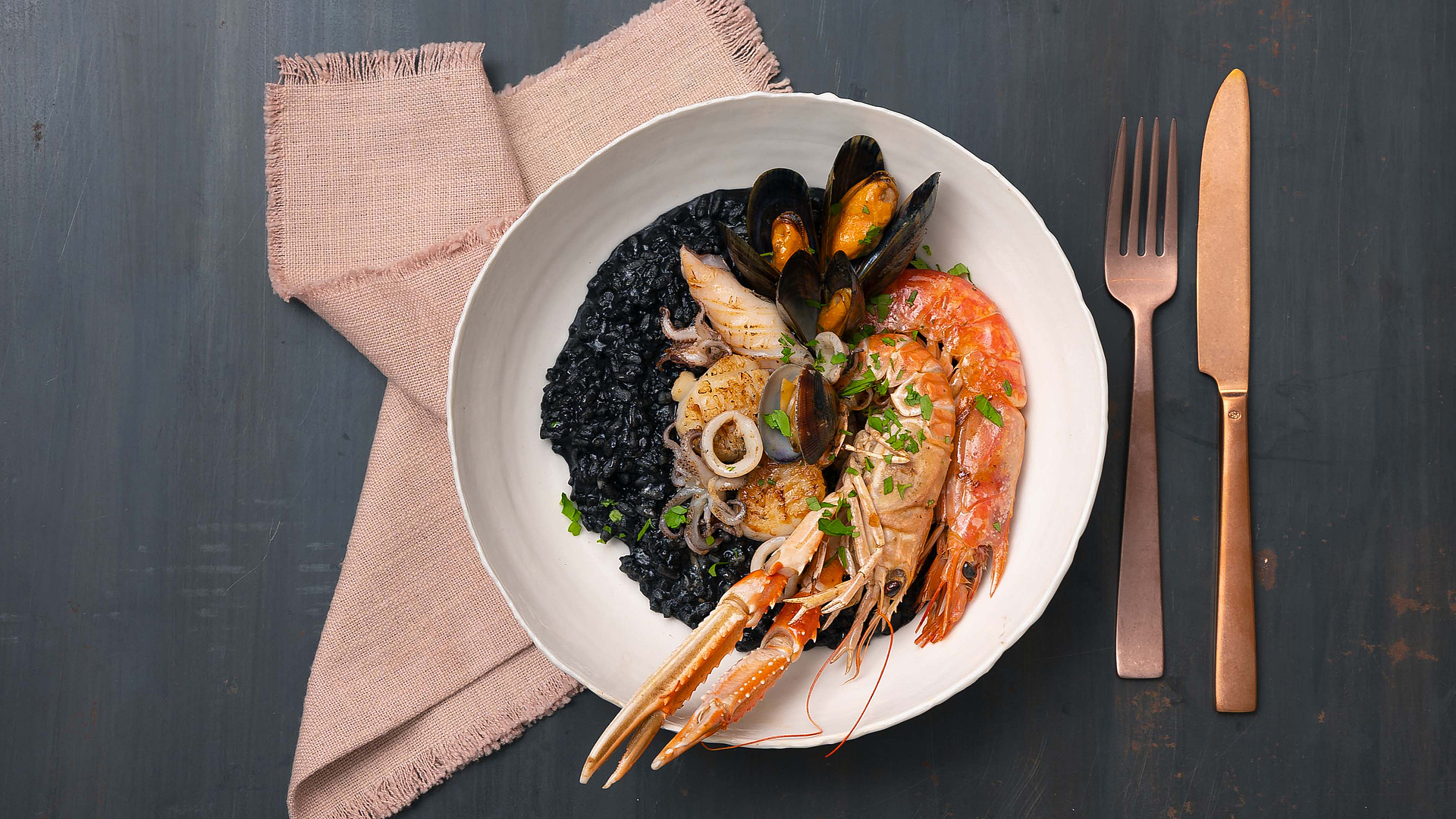 Black risotto with crustaceans
