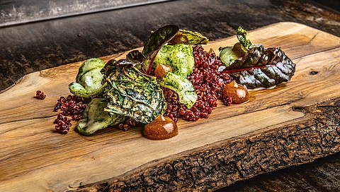 Braised Brussels sprouts with date cream, quinoa and beetroot juice