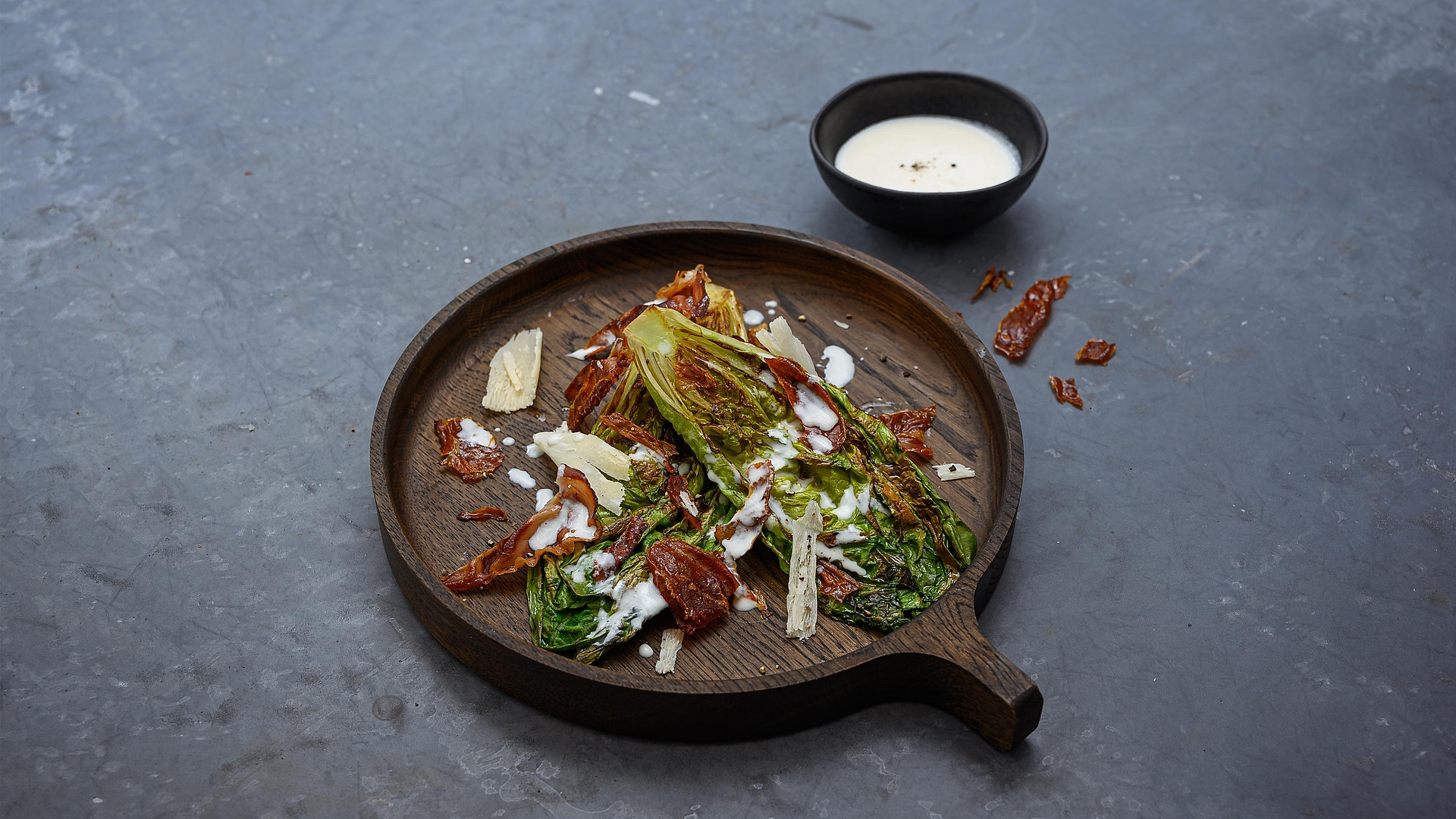 Grilled romaine lettuce with Parmesan dressing and crispy South Tyrolean bacon