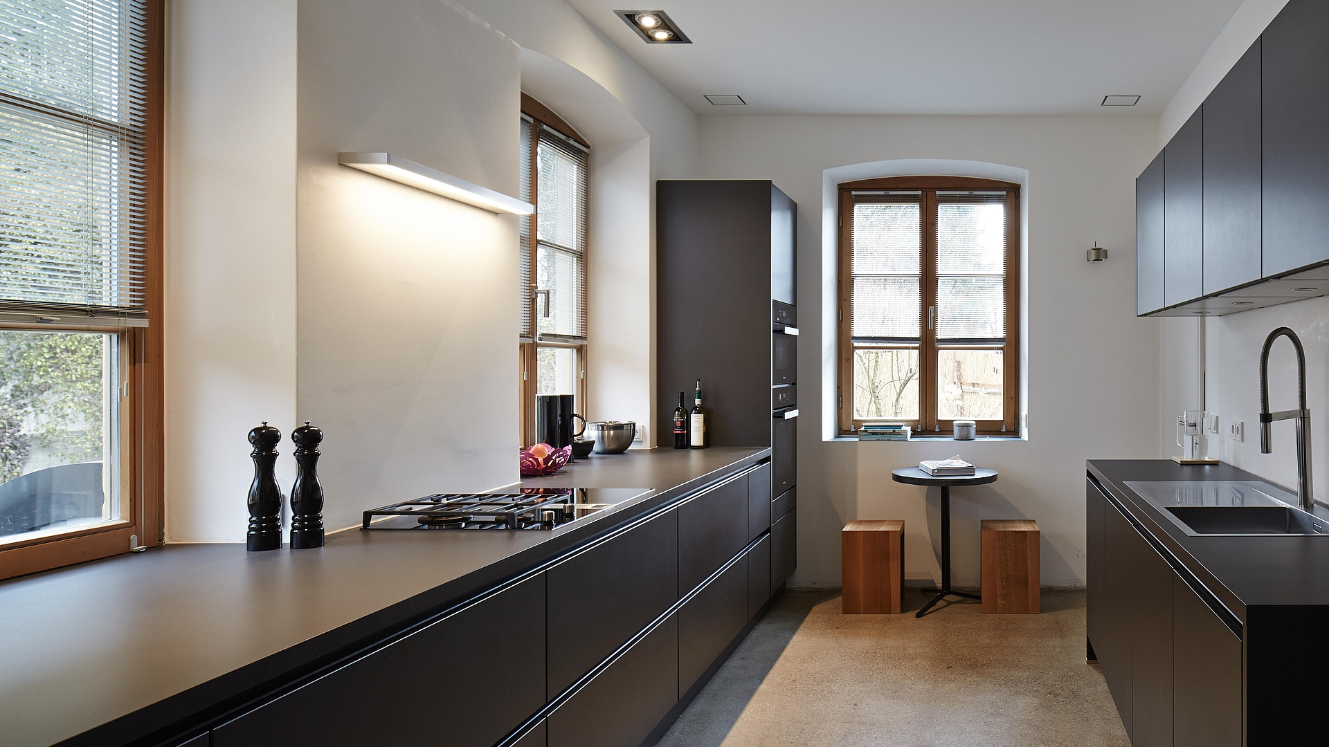 Clean kitchendesign  - Black satin varnish, stainless steel and glass