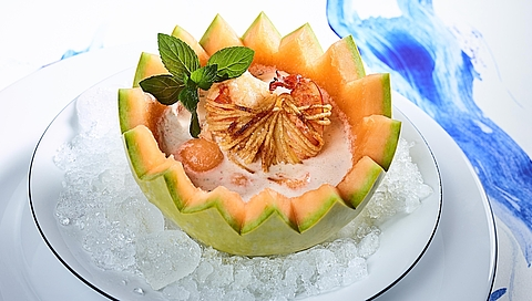Iced melon soup with crispy prawns