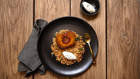 Grilled peach with spelt crumble, honey and rosemary