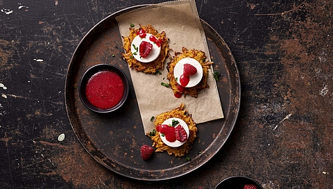 Sweet potato hash browns with feta and a raspberry dressing