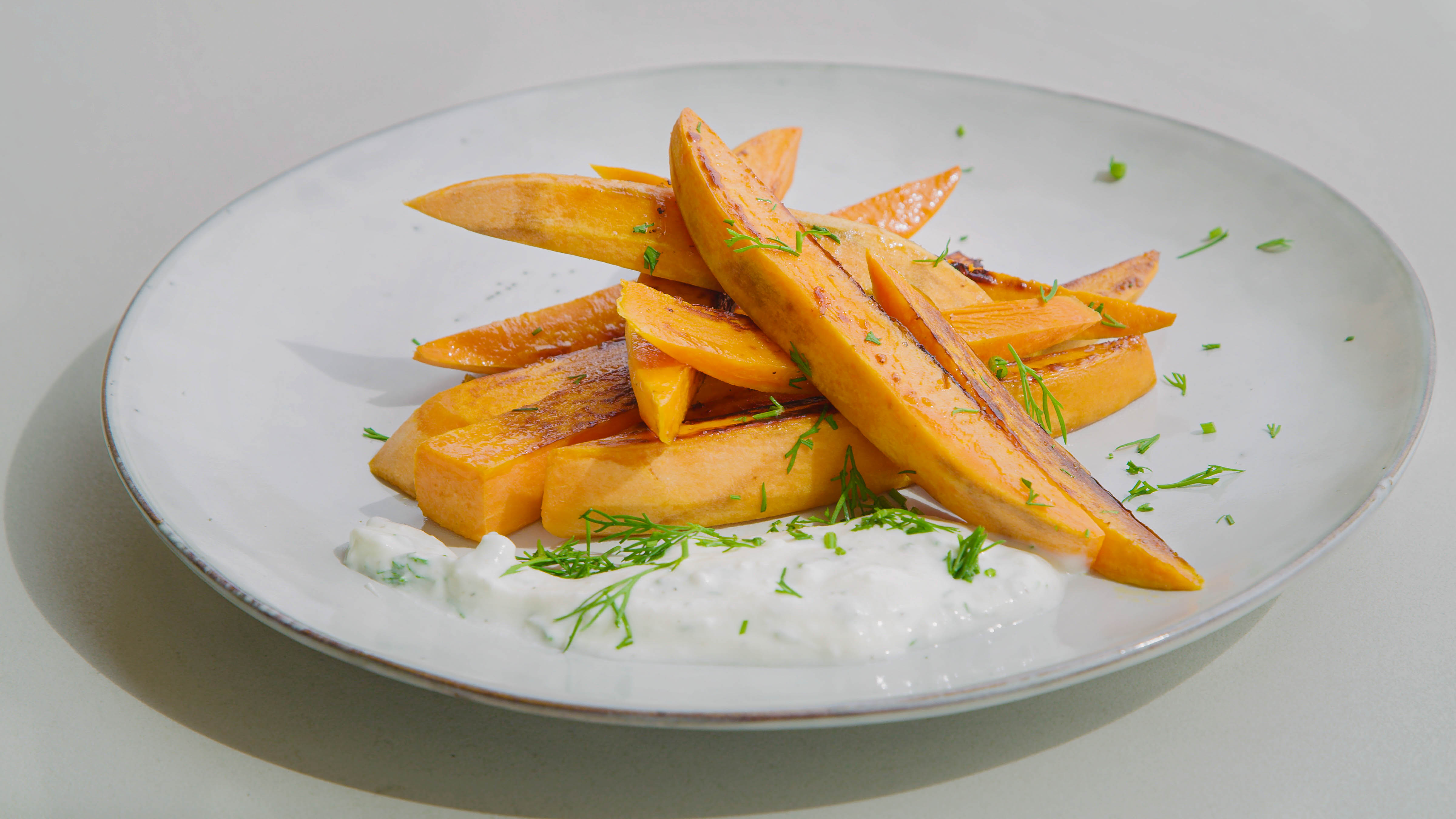 Tepan-cooked sweet potato chips with tzatziki dip