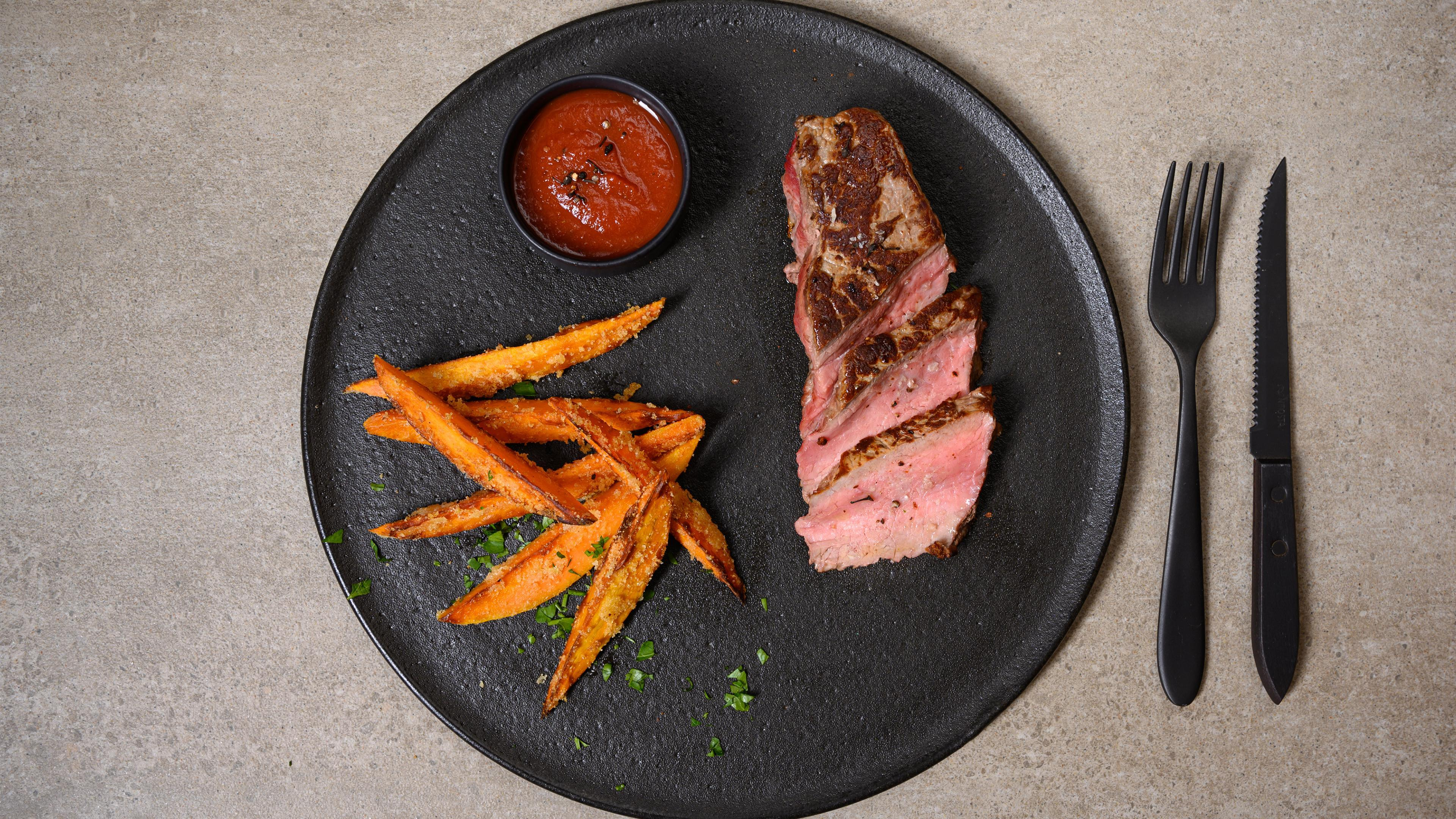 Steak and sweet potato fries with healthy barbecue sauce
