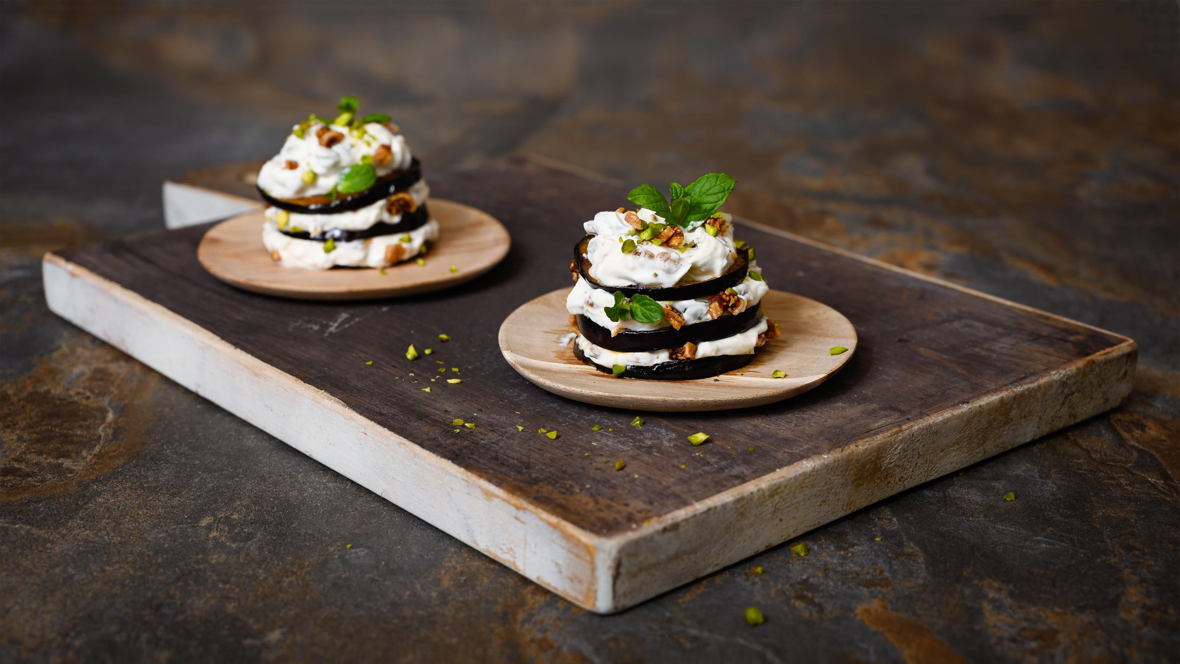 Aubergine towers with goat's cheese, pistachios, mint and dried figs