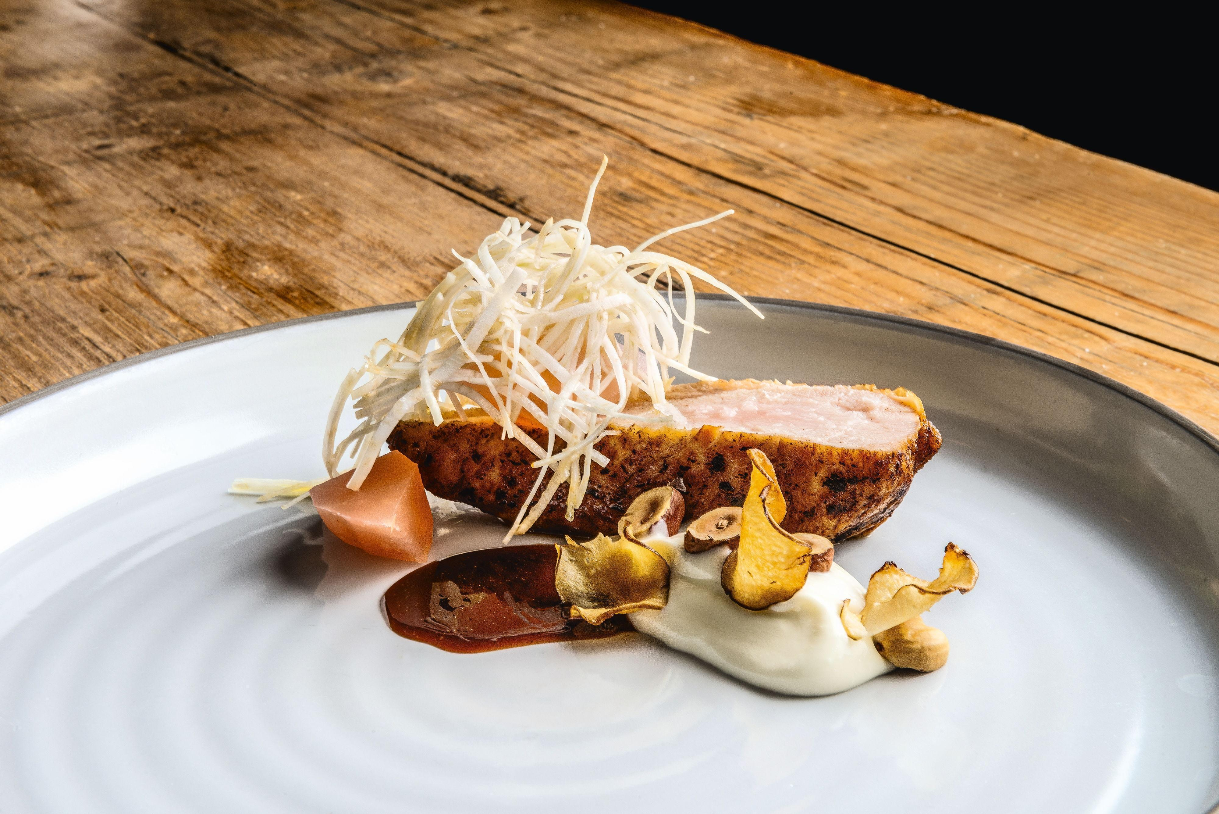 Breast of guinea fowl with a honey glaze, celeriac, apples and hazelnuts